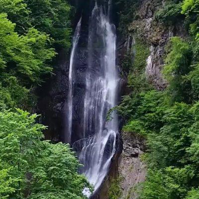 Georgia in 7 days: Makhuntseti waterfall among rocks covered with greenery